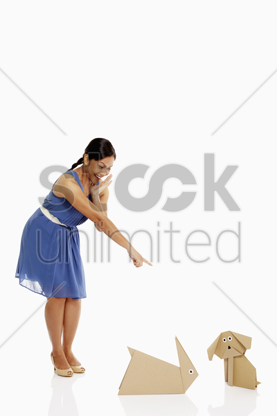 woman laughing at paper animals stock photo