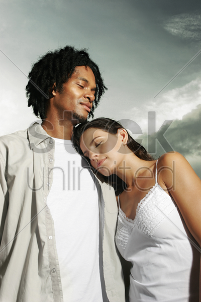 woman leaning on her boyfriend's shoulder stock photo