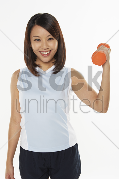 woman lifting dumbbell stock photo