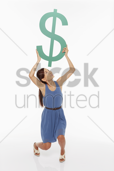 woman lifting up a dollar sign stock photo