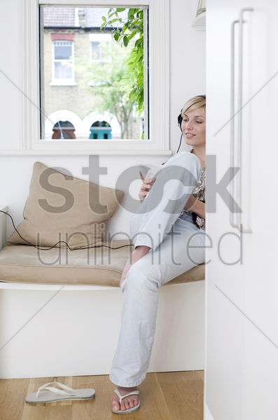 woman listening to music with headphones stock photo