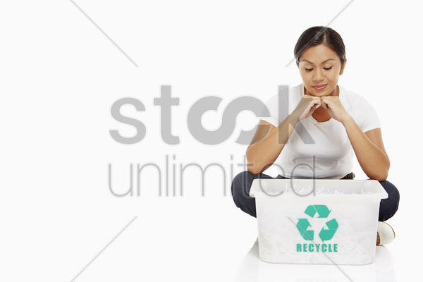 woman looking into a plastic box stock photo