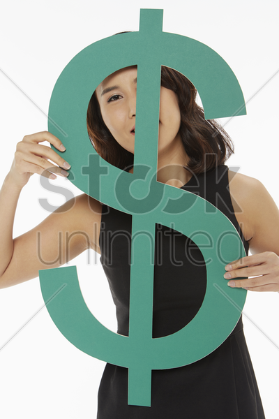 woman looking through a dollar sign stock photo