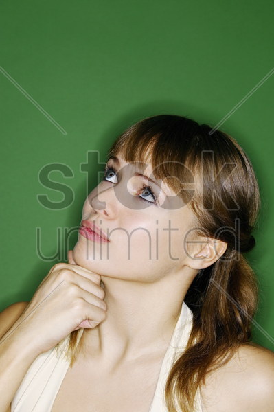 woman looking up thinking stock photo