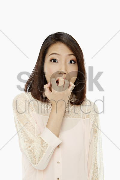 woman looking very scared stock photo