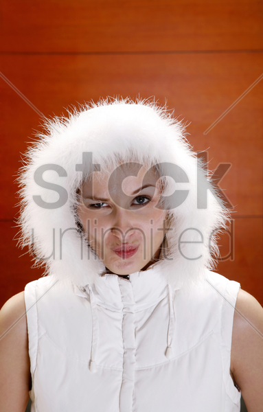 woman making a cunning look stock photo