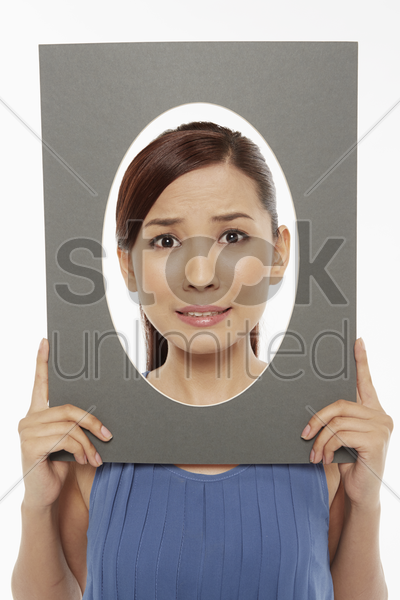 woman making faces at the camera, looking scared stock photo