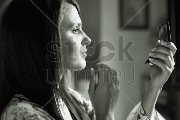 woman making-up stock photo