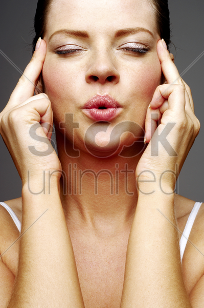 woman massaging her head stock photo