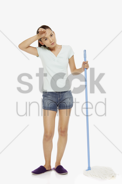 woman mopping the floor stock photo
