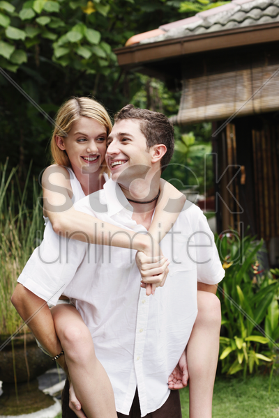 woman on man's back stock photo