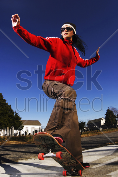 woman on skateboard stock photo