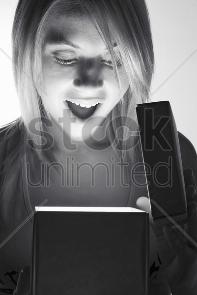 woman opening a surprise gift stock photo