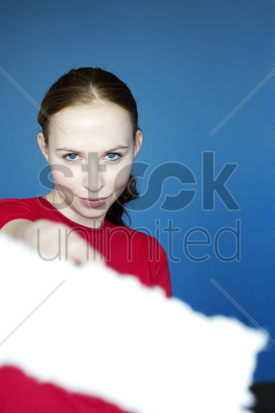 woman painting the camera with a paint roller stock photo
