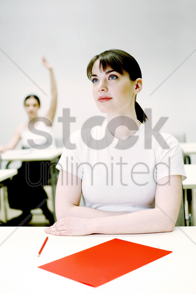woman paying attention in class stock photo