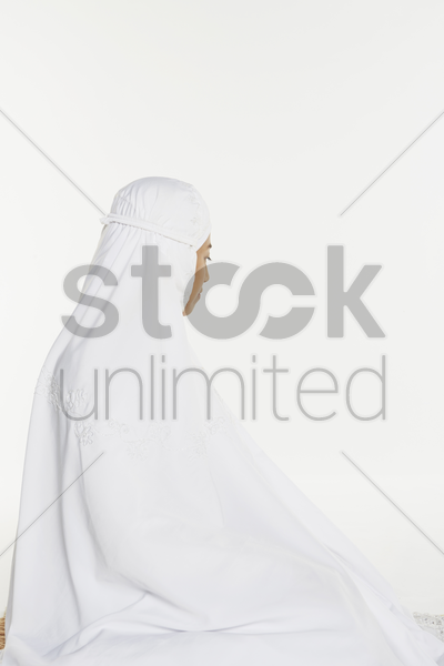 woman performing the ending salam, turning face to the left stock photo