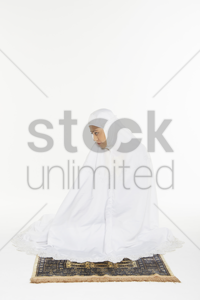 woman performing the ending salam, turning face to the right stock photo