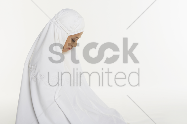 woman performing the ending salam stock photo