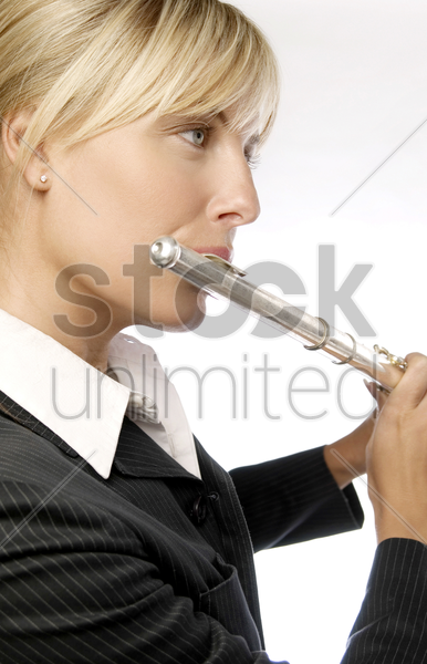 woman playing flute stock photo