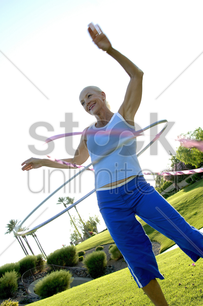 woman playing with plastic hoop stock photo
