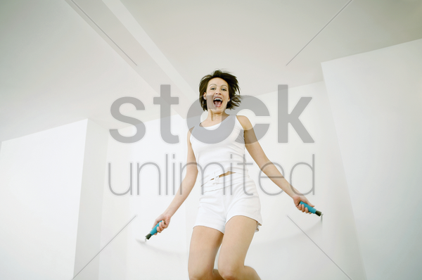 woman playing with skipping rope stock photo