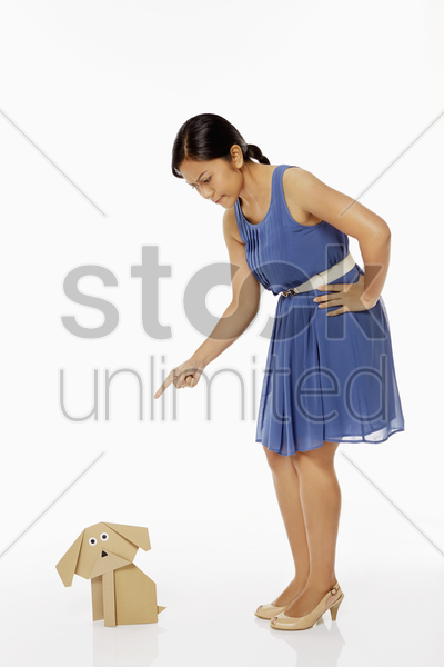 woman pointing at paper dog stock photo