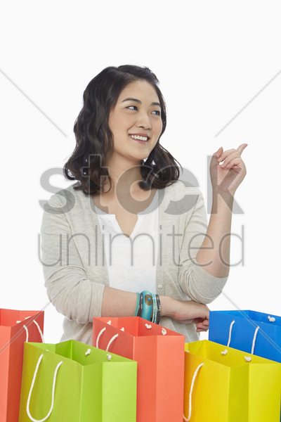 woman pointing to the left stock photo
