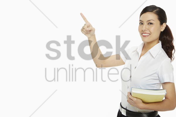 woman pointing to the right stock photo
