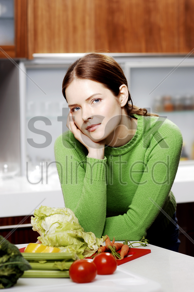 woman posing in the kitchen stock photo