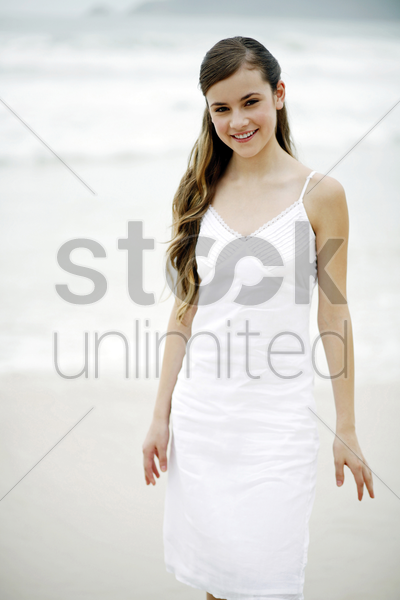 woman posing on the beach stock photo