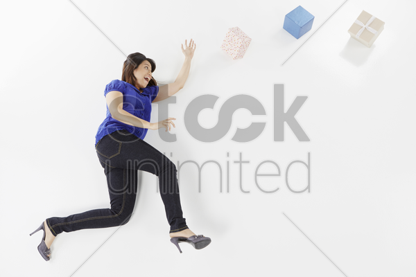 woman posing on the floor with gift boxes stock photo