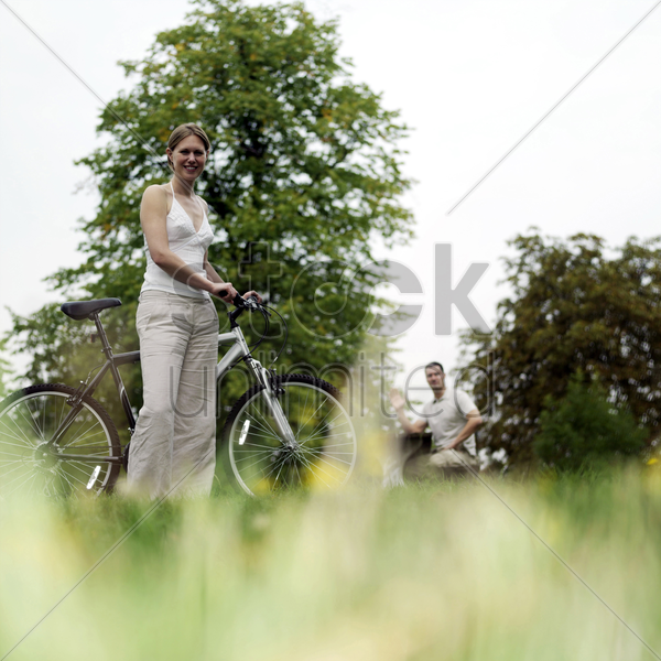woman posing with bicycle stock photo