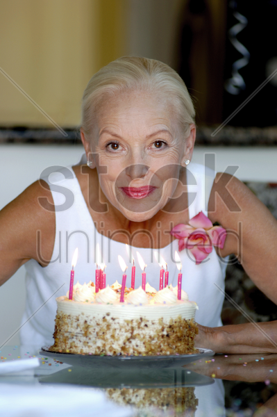 woman posing with her birthday cake stock photo