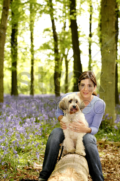 woman posing with her dog stock photo