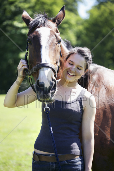 woman posing with her horse stock photo
