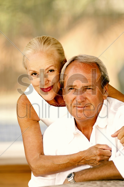 woman posing with her husband stock photo
