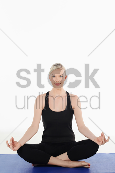 woman practising yoga stock photo