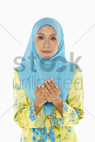 woman praying with palms placed together stock photo