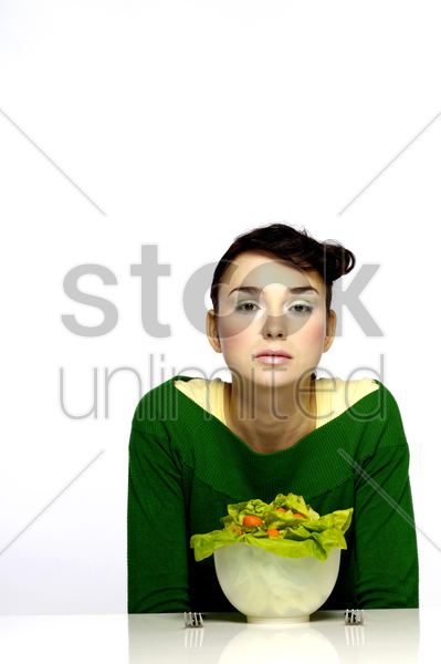 woman preparing to eat a bowl of salad stock photo