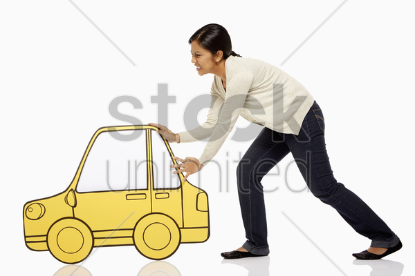 woman pushing a cardboard car stock photo