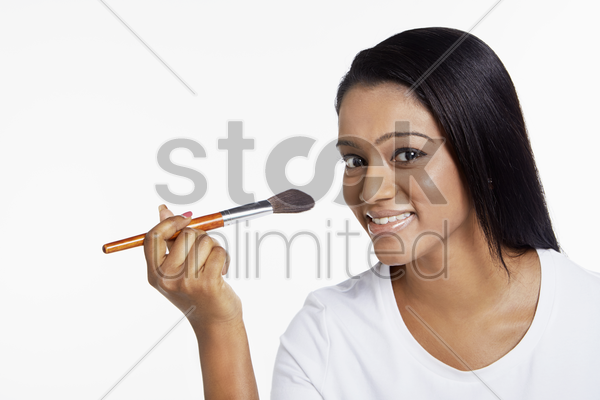 woman putting on some blusher stock photo
