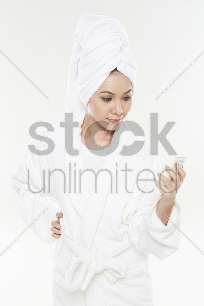 woman reading product description stock photo