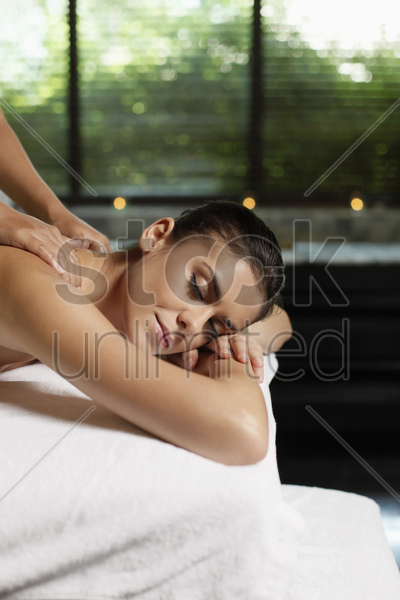 woman receiving a back massage stock photo