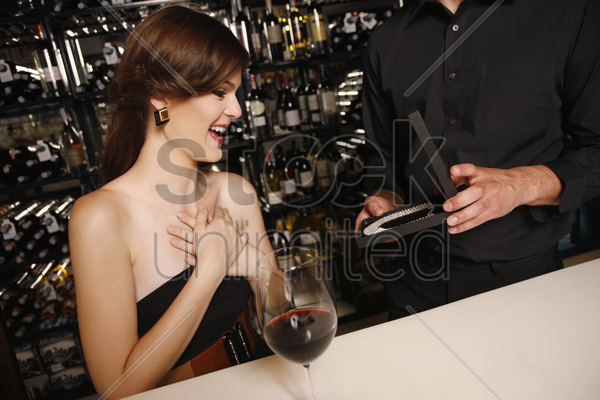 woman receiving a surprise gift stock photo