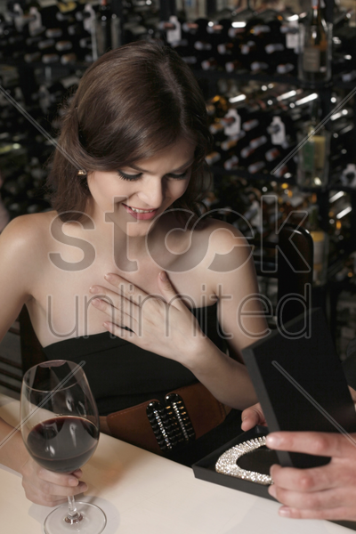 woman receiving a surprise present stock photo