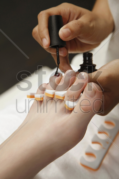 woman receiving pedicure stock photo