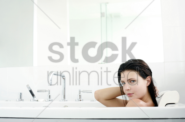 woman relaxing in the bathtub stock photo