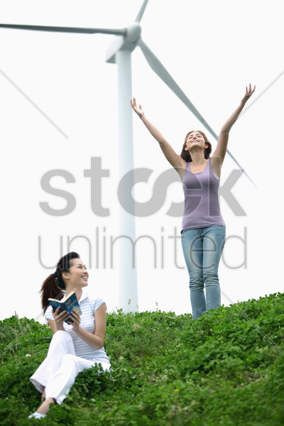 woman relaxing outdoors enjoying the cool wind stock photo