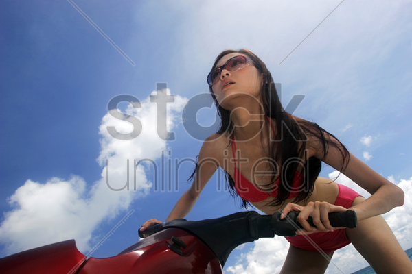 woman riding a jet ski stock photo