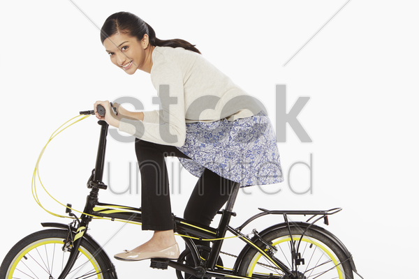 woman riding on a bicycle stock photo